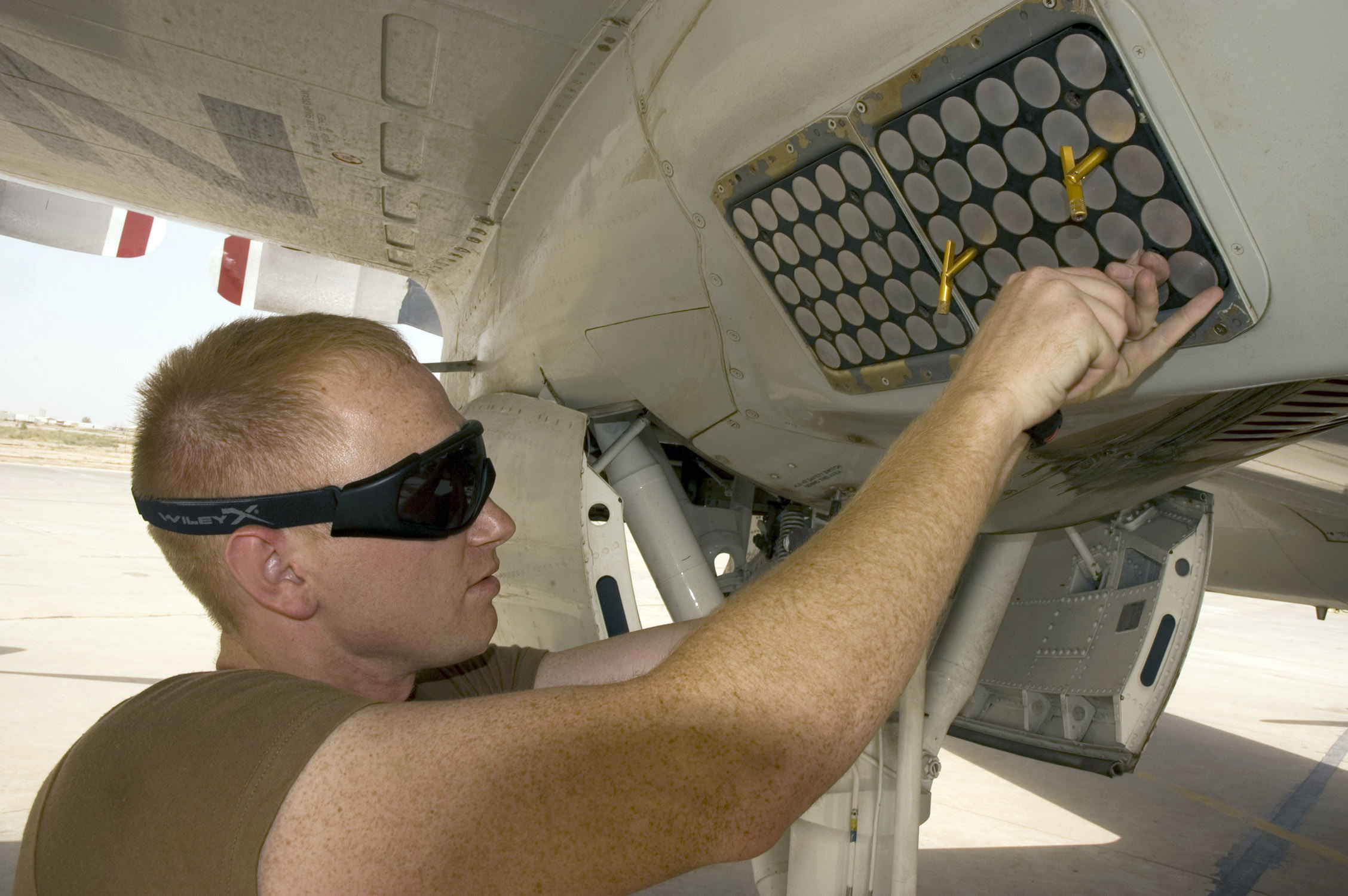 AN/ALE-47 decoy dispenser being installed aboard a USN P-3C Orion maritime patrol aircraft