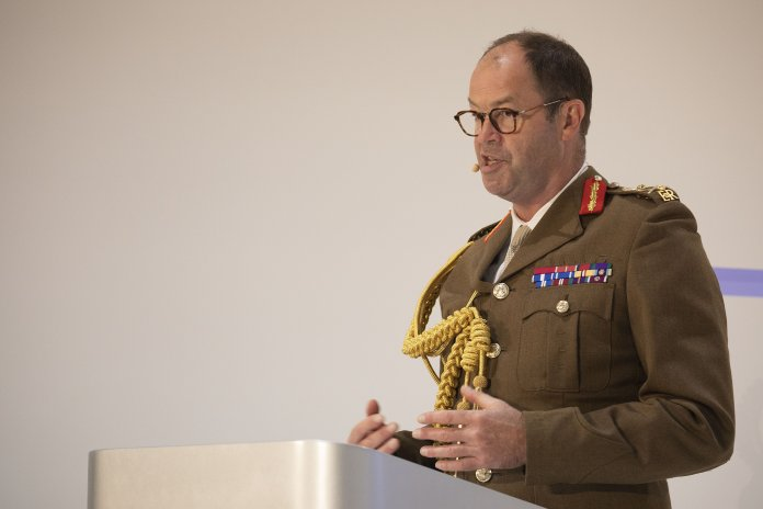 Commander of Strategic Command General Sir Patrick Sanders delivering a speech at DSEI 2021.